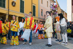 Costumed people in carnival Stock Images
