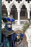 Costumed people in Venetian mask during Venice Carnival Stock Photography