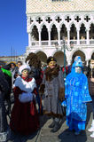 Costumed people at Venice Carnival. Doges Palace arcades and disguised people and  tourists sightseeing on Venice square,Italy.Photo taken on February 8th,2015 Stock Image
