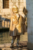 Costumed person in Venetian mask. During Venice Carnival in Venice Royalty Free Stock Photography