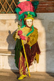 Costumed person in Venetian mask Royalty Free Stock Photo