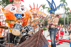 Costumed revelers march with floats in the annual Dream Parade o Royalty Free Stock Image