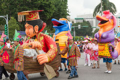 Costumed revelers march with floats in the annual Dream Parade o Stock Image