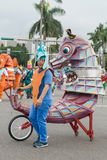 Costumed revelers march with floats in the annual Dream Parade o Stock Photo
