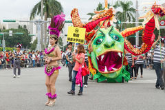 Costumed revelers march with floats in the annual Dream Parade o Royalty Free Stock Images