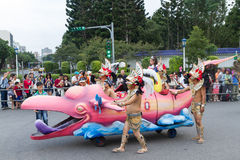 Costumed revelers march with floats in the annual Dream Parade o Stock Images