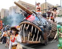Costumed revelers march with floats in the annual Dream Parade o Stock Photography