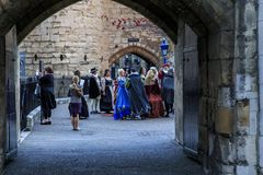 Costumed tour of the Tower of London. LONDON, GREAT BRITAIN - SEPTEMBER 21, 2014: Unidentified visitors are preparing for a costumed excursion to the night Tower Stock Images