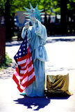 Costumed woman playing the statue of liberty. USA, NEW-YORK, APRIL 23: A unidentified costumed woman playing the statue of liberty in New-York.2006 Stock Photos