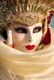 Costumed woman during venetian carnival, Venice, Italy. VENICE - FEBRUARY 21: Venetian costumed woman during venetian carnival on February 21, 2014 in Venice Stock Photo