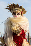 Costumed woman during venetian carnival, Venice, Italy. VENICE - FEBRUARY 21: Venetian costumed woman during venetian carnival on February 21, 2014 in Venice Royalty Free Stock Images