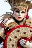 Costumed woman during venetian carnival, Venice, Italy. VENICE - FEBRUARY 21: Venetian costumed woman during venetian carnival on February 21, 2014 in Venice Royalty Free Stock Photos