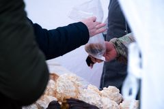 Costumer buying ecler pastry covered with chocolate at the food market.  stock images