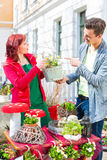 Costumer buying flower in flower shop Stock Photos