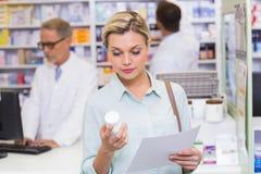 Costumer holding prescription and medicine jar Stock Photo