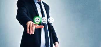 Costumer review concept, man rating service by clicking  on happy smiling face  symbol.  stock photo