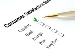 Costumer satisfaction survey. Survey in a white paper, checked in the excellent checkbox royalty free stock image