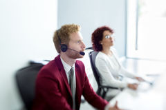 Costumer Service Agent. Male costumer Service Agent at work Royalty Free Stock Photography