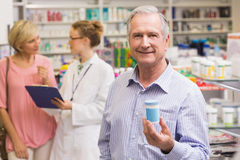 Costumer showing medicine jar. At pharmacy royalty free stock photo