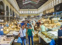 Costumers in Varvakios, Central Market of Athens. Attica region, Greece. Athens, Greece - July 2, 2018. Costumers buying fish in Varvakios, Central Market of royalty free stock images