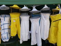 Costumes beekeepers - different colors stock photos