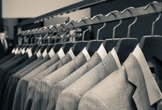 Costumes d'hommes Photos stock