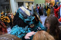 Konstanz Fasnacht Costume. Costumes of demon during the 2019 Konstanz Fasnacht / Karneval parade. Messing up hair of parade watcher stock images