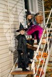 Costumes on halloween. Happy children in a costumes of witches and wizards celebrating halloween. Trick or treat. Halloween party Stock Images