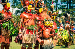 Costumes in Papua New Guinea. Hagen show, Papua New Guinea - circa August 2015: Half-naked men during Hagen show, Papua New Guinea. Documentary editorial Stock Image