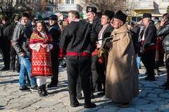 Costumes tradicionais do inverno com máscaras em Bulgária Foto de Stock Royalty Free