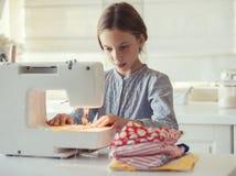 Costura da criança Fotografia de Stock