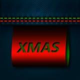 Costura de los vaqueros con la etiqueta de Navidad Imágenes de archivo libres de regalías
