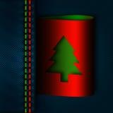 Costura de los vaqueros con la etiqueta del árbol de navidad Fotos de archivo libres de regalías