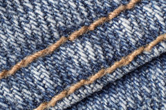 costura macra de los tejanos Imagenes de archivo