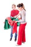 Costureras que eligen la tela Imagen de archivo libre de regalías