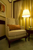 Cosy antique chair and lamp Royalty Free Stock Photos