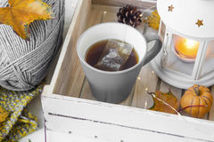 Cosy autumn with tea cup, lantern and knitting wool Stock Photo