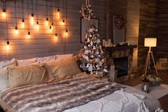 Free Cosy Bedroom With Eco Decor. Wood And Nature Concept In Interior Of Room. Scandinavian Interior With Christmas Tree, Real Photo. H Stock Photos - 160429153