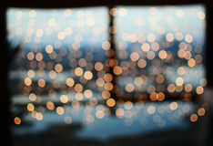 Cosy bookeh Christmas lights on window Royalty Free Stock Images