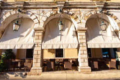 Cosy cafe in of a typical Venetian building in Kerkyra city on the island of Corfu, Greece. Stock Photo