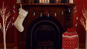 Cosy Christmas holiday decorated mantelpiece and fire place. In red and white theme Royalty Free Stock Image