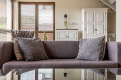 Cosy couch idea. Cosy couch with pillows in comfortable living room royalty free stock photography