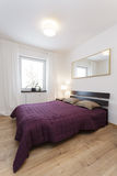 Cosy flat - violet bedroom Stock Images