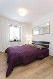 Cosy flat - violet bedroom. Cosy flat - huge purple bed in modern bedroom Stock Images
