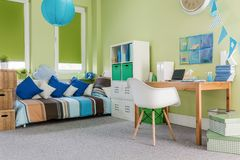 Cosy furnished functional room. Image of green cosy furnished functional room for child royalty free stock photography