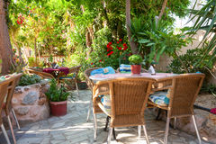 Cosy greek cafe terrace Royalty Free Stock Photo