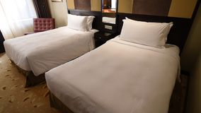 Cosy hotel beds stock video