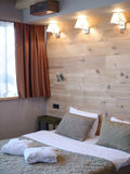 Cosy hotel room. Bathground with bed stock photography