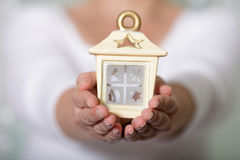 Cosy house in hands. Woman holding a cosy house in her hands stock image