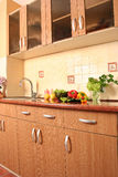 Cosy kitchen. Fresh vegetables in a cosy kitchen stock photos